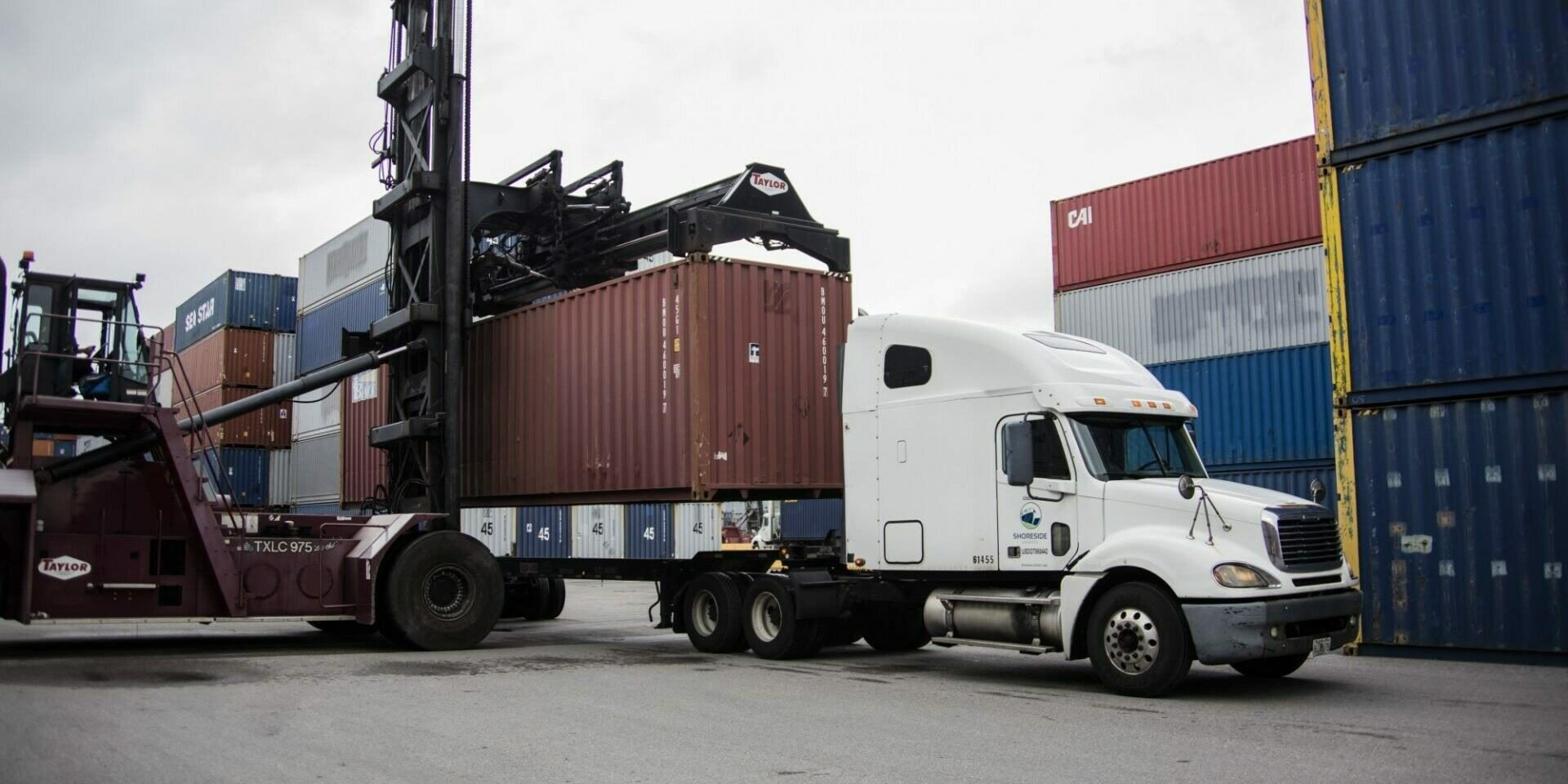 Loading containers on a transport truck